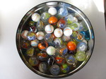 Round Tin with 78-Collectable Shooter Size Marbles