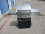 USED-Capt'n Cook 4-Burner  Propane Gas Grill With 2-side tables and on stand