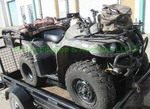 2005 Yamaha Bruin 350 4 x 4 Quad runner packed with accessories, Runs & drives good, please see videos. matches lot 7