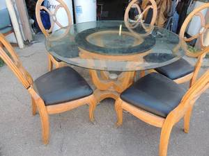 "Very nice large glass top kitchen table with 5 chairs solid wood chairs have claw feet   - 53  1/2 round 30"" tall.   chairs 42  1/2 tall brown and black"