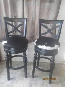 "TOTAL OF 2  ANTIQUE  BLACK AND WHITE GENUINE COWHIDE AND WOOD  COUNTER  HEIGHT BAR STOOLS 32"" FROM FLOOR TO SEAT  SEAT 17"" DIAMETER"