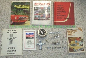 Genuine 1965 Ford Mustang emblems with Mustang repair and parts books