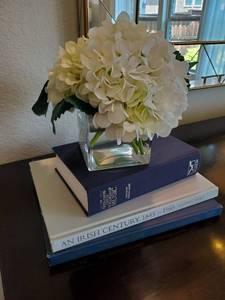 Faux White Flower in Glass Vase with Books