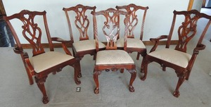 Georgian/Regency style custom order chairs. Carved pierced scroll back with Cabriole legs terminating with Claw and Ball feet. Upholstered seat. Carved shell apron and scroll accents. 2-Captains chairs with arms and 8 side chairs.