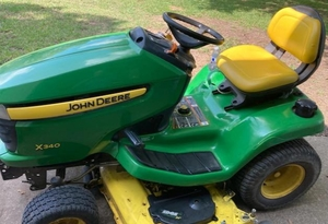 "JOHN DEERE X340 LAWN TRACTOR WITH 54"" DECK IN RUNNING CONDITION. THIS UNIT HAS BEEN KEPT INSIDE A BARN SO IT IS IN GREAT OVERALL CONDITION AS SHOWN. CHECK IT OUT!!"