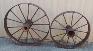 "2 cast iron wagon wheels 32"" and 27"" (very Heavy)"
