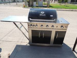 "Master Forge propane grill  Silver and black with 3 doors 51"" w 22""d 49"" h"