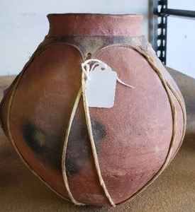 Possibly Native American Clay Pot with Animal hide Straps