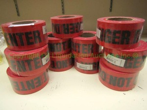 """Do Not Enter"" red safety tape rolls, unopened"