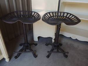 2 cast iron backless bar stools with foot rest. Can swivel or lock in place 25x18x14.