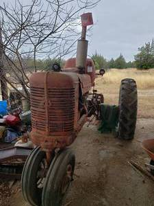 Vintage Farmall Tractor was running when parked a few years ago. current condition unknown.