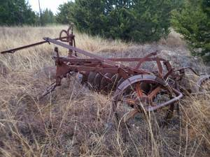 Antique disk plow with steel wheels