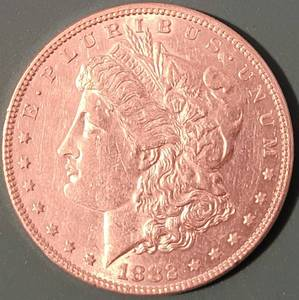 1882 MORGAN SILVER DOLLAR COIN AS SHOWN.