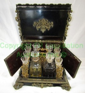 Antique late 1800's casket wet bar complete with black lacquer finish and brass ormolu embellishments, 15 x 15 x 12