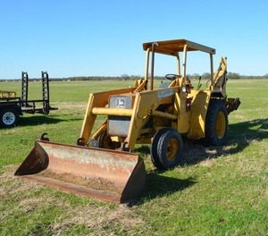 John Deere Tractor 310A, bucket and backhoe. Forklift Fork Included. (Needs new seat) runs and starts battery currently disconnected Checkout the videos of it running on Facebook D&S Specialties link below