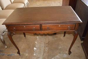 Antique Ribbon Mahogany Writing Table with Dual Front Drawers, Cabriole style legs and Wheels