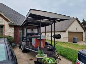 LARGE ROOF TRAILER WITH CUSTOM-MADE SMOKER, TWO CUSTOM-MADE PROPANE GAS BURNERS, MOUNTED GRILL, ISLAND/PREP STATION WITH STORAGE, SINK AND FAUCET PLUS WATER RESERVOIR TANK AND MORE. TRAILER HAS POWER OUTLETS AND LIGHTS AS SHOWN.